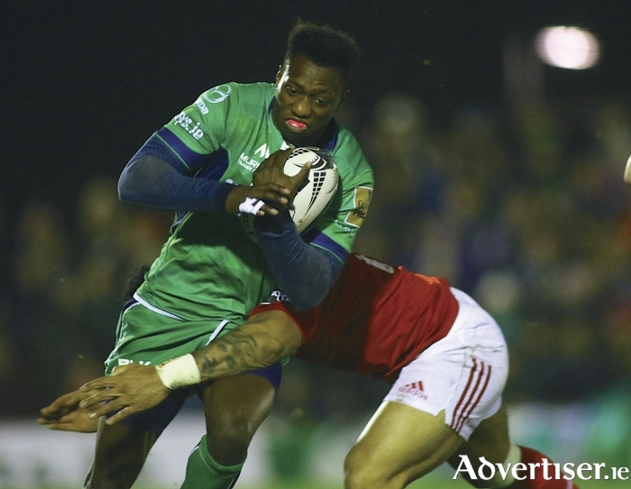 Niyi Adeolokun is tackled by Munster's Francis Saili in action from the Guinness Pro12 game at the Sportsground on Saturday. Photo: Mike Shaughnessy