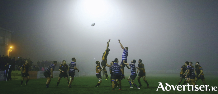 Corithians and Buccaneers contest a line out in a fog shrouded Corithian Park during the Connacht Senior Cup final on Friday night. Photo:-Mike Shaughnessy