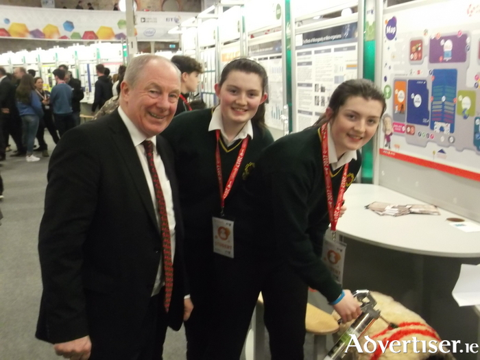 Michael Ring TD, Minister of State for Regional Economic Development, Sarah Murphy and Mary Murphy from Jesus and Mary Secondary School, Gortnor Abbey, Crossmolina at the BT Young Scientist and Technology Exhibition.
