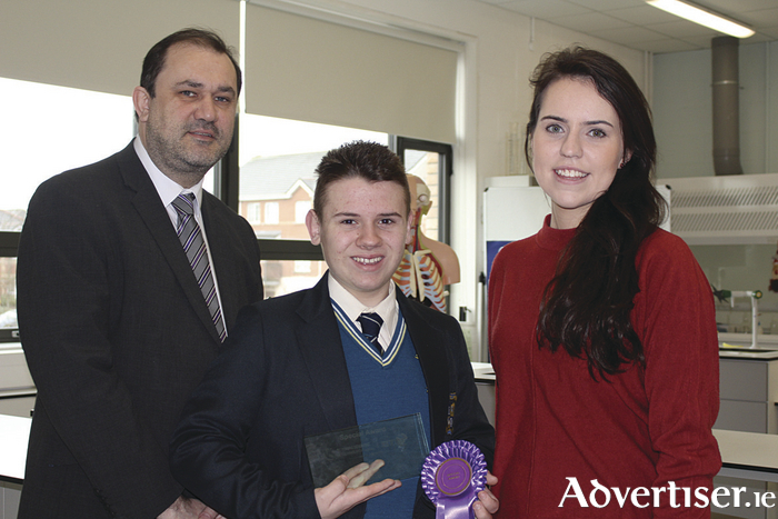 Ian McDonagh of Merlin College, pictured with principal John Cleary and science teacher Claire Cunningham.