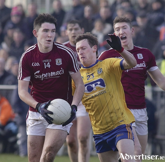 Galway's Barry McHugh, who has enjoyed an impressive campaign at full forward,  and Roscommon's Conor Devaney in the FBD Connacht Football League final in Kiltoom on Sunday. 		Photo:-Mike Shaughnessy