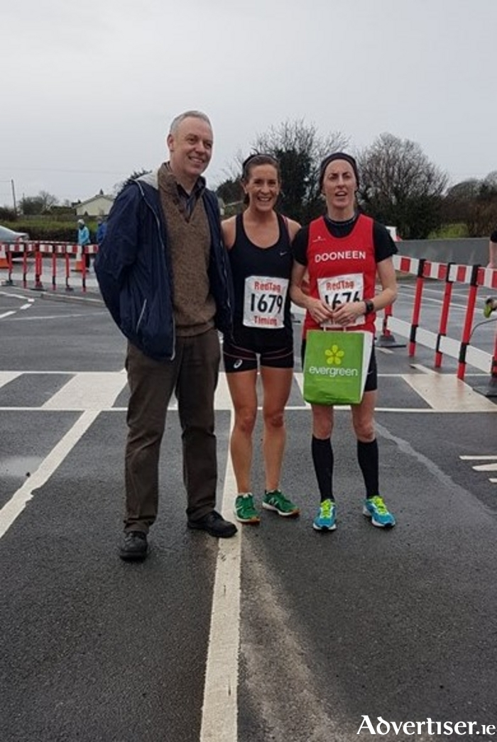 Harry Monson, Coldwood four mile race director, with race winner Breege Connolly and Rosemary Ryan, second.
