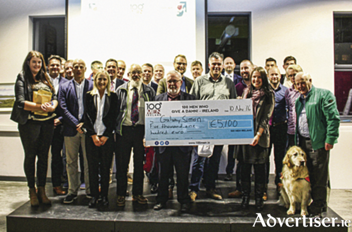 CEO, Bill Griffin and Fundraising Manager, Deirdre Treacy of Galway Simon Community are presented with a cheque from 100 Men Who Give A Damn! for €5,100 on the night of the pitch event with an additional €800 donated later.