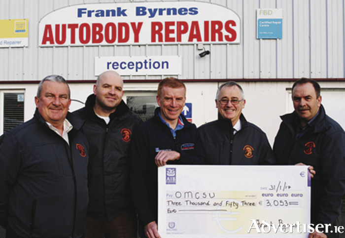 Frank Byrnes (Centre) presents proceeds of the #NeverGiveUp challenge to volunteer members of the Oranmore Maree Coastal Search Unit L to R; Stephen Sullivan, Mike Cummins,Sean Green and Brendan Commins. Frank ran a total of 206km.