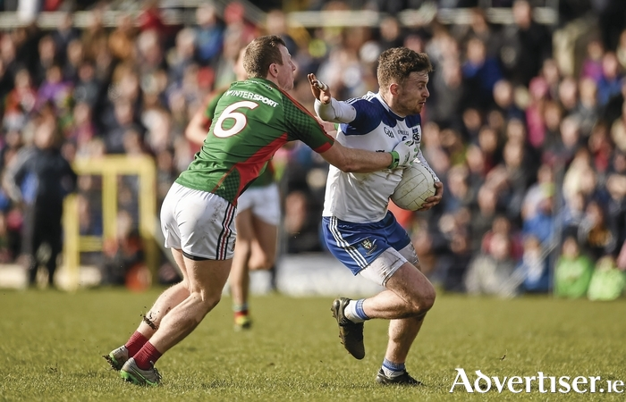 Man and Boyle: Monaghan's Fintan Kelly tries to break the tackle of Mayo's Colm Boyle in last year's league meeting between Mayo and Monaghan. Photo: Sportsfile.