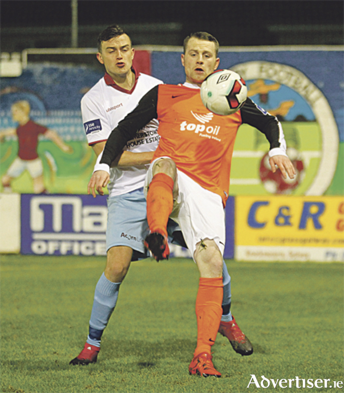 New Athlone Town signing Jason Molloy keeps the ball away from Marc Ludden of Galway United