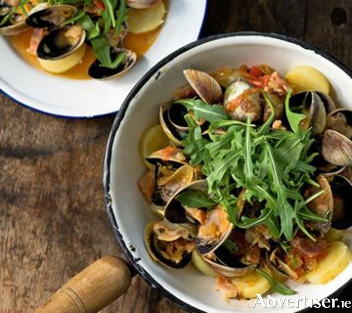 Steamed clams and mussels cooked in a chilli and bacon broth with rocket.