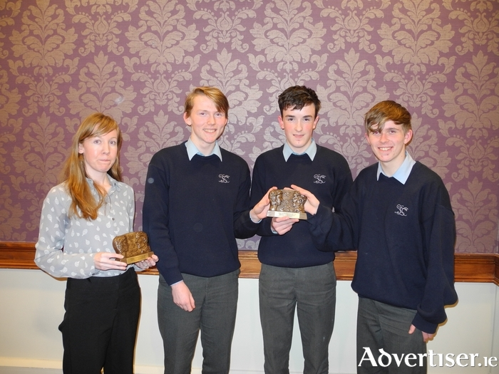 Pictured celebrating their win with their proud teacher, Caitlín Ní Níolláin (left) at the regional finals of Comórtas An Phiarsaigh Gael Linn held in Claremorris on Tuesday, 7 February last are the junior debating team from St Gerald's College, Castlebar Cillín Ó'Lochnáinn, Seaghan Ó'Ceallaigh and Oisín DeBrún