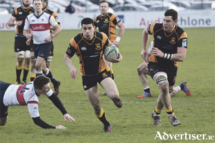 Jordan Conroy rounds Old Wesley's Alan Jeffares on his way to scoring Buccs' second try. Photos: Tom O'Neill