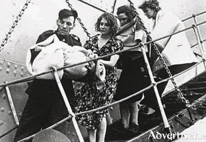 Some of the rescued Athenia passengers disembarking from the Norwegian freighter Knute Nelson.