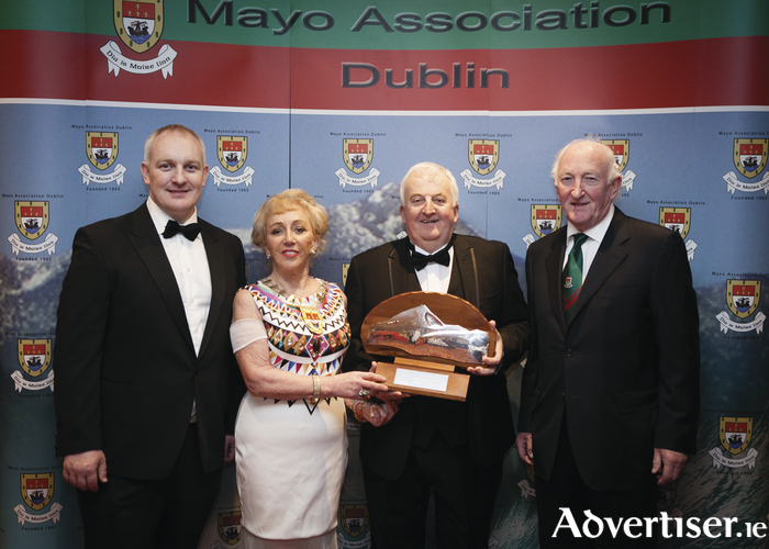 Paul Sammin (Chairman), Dr. Mona McGarry (President) and, John Gallagher present Sean Kelly with the Mayo Association Dublin, Mayo Person of the Year award. Photo: Brian Ryan