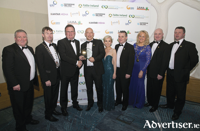 Members of Mayo Sports Partnership and Mayo County Council collect their award from LAMA.