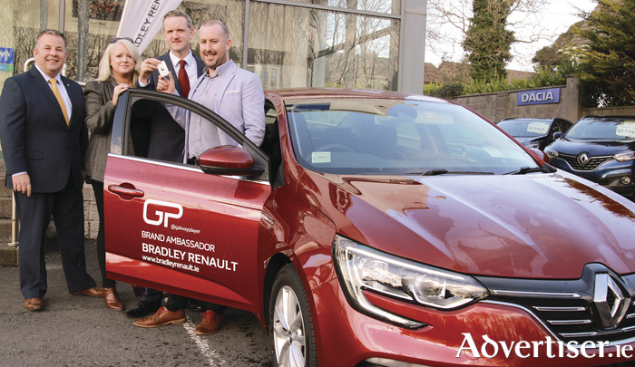 Pictured handing over the keys of the new Renault Megane grand coupé were Enda Cantrell, Gillian Bradley and Robert Bradley, all of Bradley Renault, with Kieran O'Malley, aka the Galway Player.
