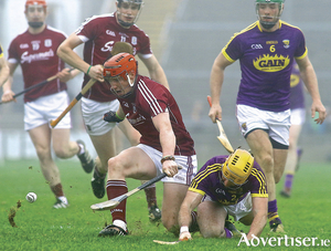 Galway's Conor Whelan and Wexford'd Eoin Moore in action from the Allianz Hurling League game at Pearse Stadium on Sunday.			Photo:-Mike Shaughnessy