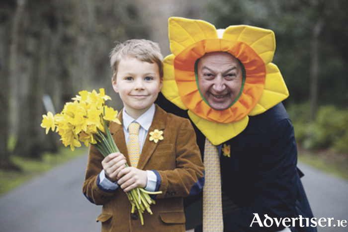 Businessman Bobby Kerr is pictured with Luke O'Donnell (age 7) urging corporates around the country to get involved in Daffodil Day, March 24. Photo: Andres Poveda