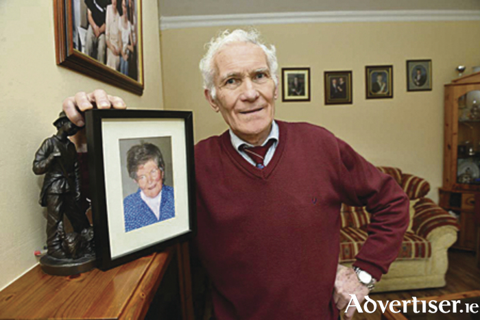 Pictured is Peter Mulryan with a picture of his late Mother Bridget.