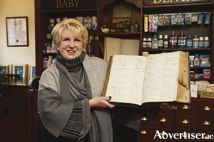 Brigid Brophy, with the  prescription book from O Beirn's pharmacy showing the ingredients for the cream which helped Sidney Worrall survive. Her mother was Silé O Beirn.*