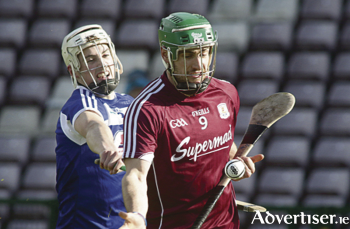 Cian Taylor of Laois fails to stop Galway's David Burke in action from the Allianz Hurling  League game at Pearse Stadium on Sunday.		Photo:-Mike Shaughnessy