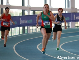 Mary  Roache going for gold in the W45 400 metres.
