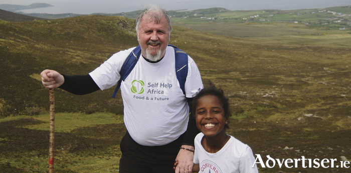 Ronan Scully and his daughter Mia Scully training for his charity walk.