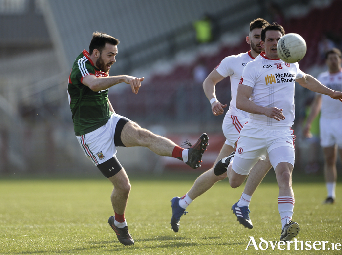 Up and over: Kevin McLoughlin kicks the winning point for Mayo on Sunday. Photo: Sportsfile