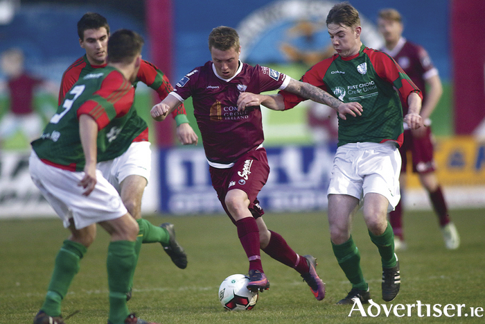 Galway United's Jesse Devers tussles with Mayo League's Sean Morrisey in action in the EA Sports Cup first round game at Eamonn Deacy Park on Monday night. 				Photo:-Mike Shaughnessy