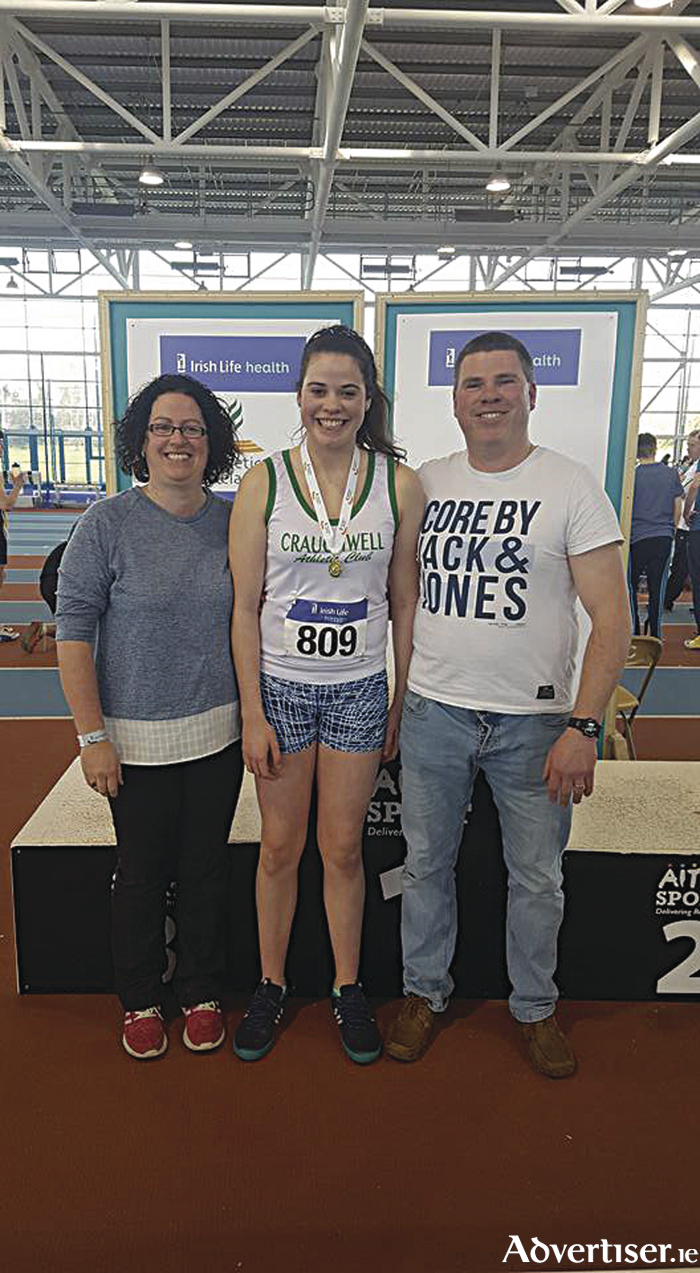 Chloe Casey , Craughwell AC, U16 shot putt winner and record breaker with her family.