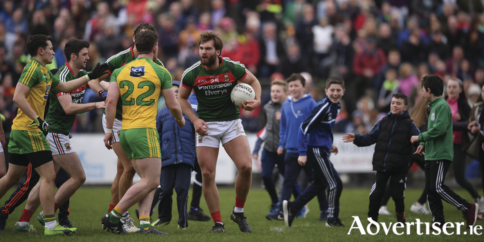 Aidan O'Shea has a frank exchange of views with Patrick McBrearty at full time. Photo: Sportsfile