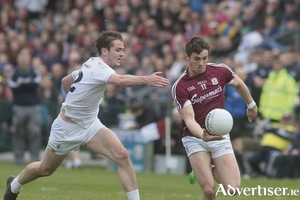 On attack: Impressive Shane Walsh of Galway escapes Kildare's Con Cavanagh in Pearse Stadium on Sunday.			Photo: Mike Shaughnessy