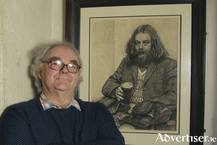Johnny Finn, with a portrait of his late brother Mickey. Photo:- Mike Shaughnessy