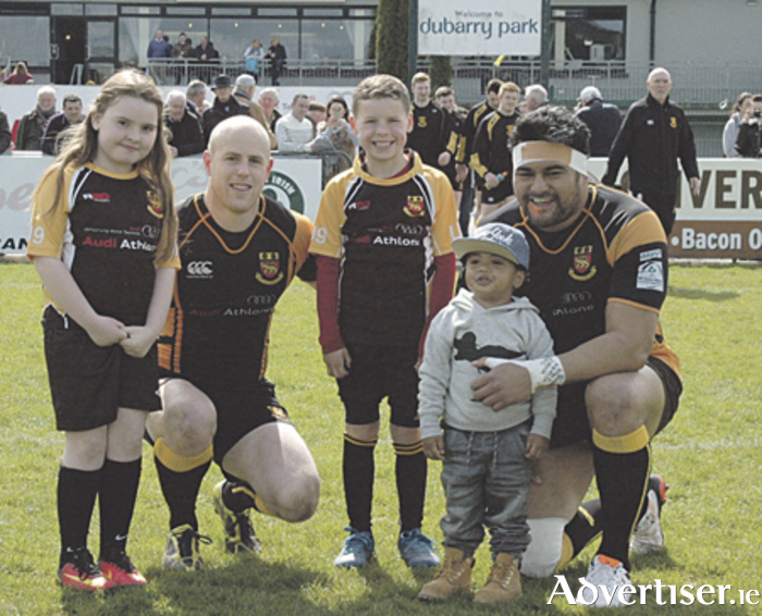 Buccaneers captain Kolo Kiripati is pictured with his son Niall, Alex Hayman, and with mascots Eva Breslin and Dean Browne prior to his final match