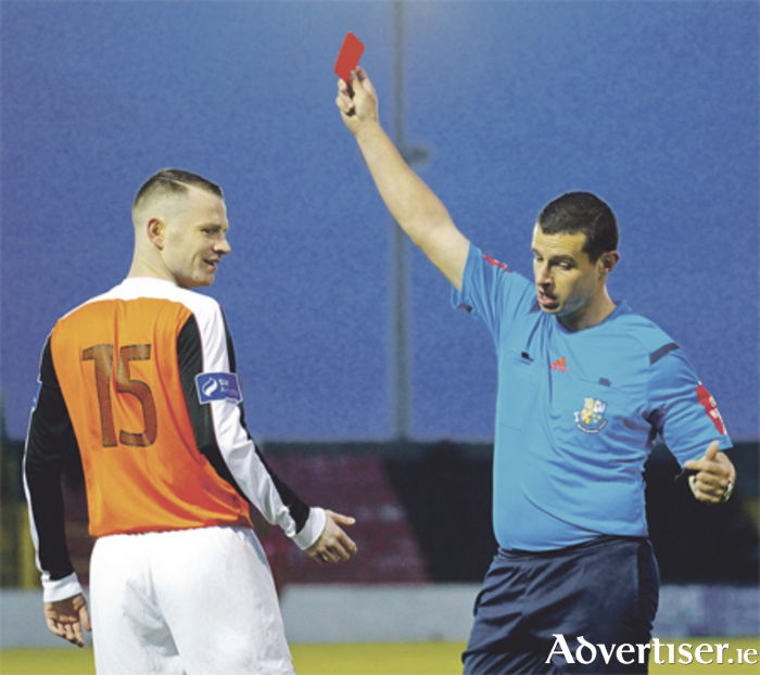 Referee David Keeler shows Jason Molloy a straight red card just two minutes after the Athlone player came on as a substitute.  Photo: Ashley Cahill/AC Sports Images
