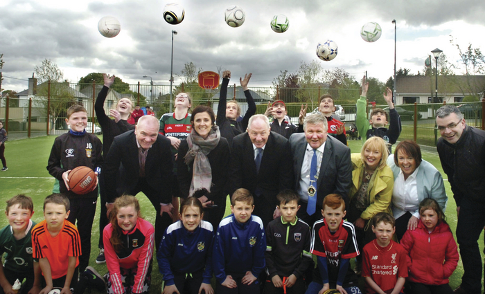 Minister of State for Rural Economic Development Michael Ring, pictured with delighted youngsters after officially opening Abbeytown Crossmolina's new Multi Use Games Area. Also included at the opening were Mayo County Council, Parks Superintendant Peter Gill, Senator Michelle Mulherin, Ballina Municipal District Cathaoirleach Cllr Michael Loftus, head of Ballina Municipal District Marie Crowley, Mary Gordon, administrative officer Mayo Co Council, and Dara Calleary TD. Picture: Henry Wills.
