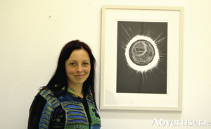 Artist Patricia Boomba with one of her works from the CODA exhibition.