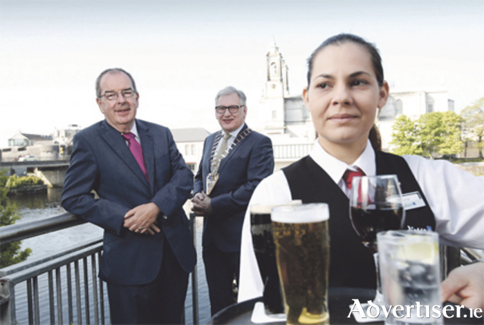 Pictured at the 44th AGM of the Vintners' Federation of Ireland are VFI chief executive, Pádraig Cribben, president Pat Crotty, and Lizzy Costa from the Radisson Blu Hotel Athlone. Photo: Conor McCabe Photography
