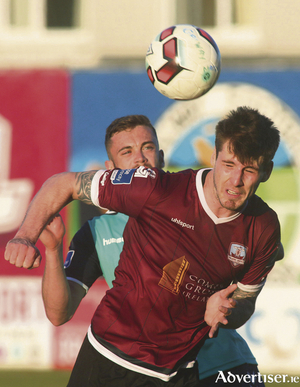 Stephen Folan of Galway United is chased by Derry City's Nathan Boyle in action from the SSE Airtricity League game at Eamonn Deacy Park on Monday night. Photo:-Mike Shaughnessy