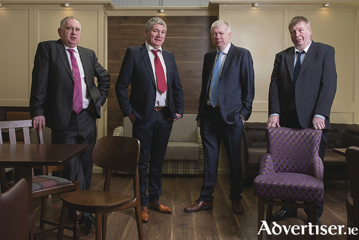 Richard, Michael, Peter, and Paddy Monaghan of Monaghan Bros Bar Furniture Manufacturers Ltd from Mayo Abbey.