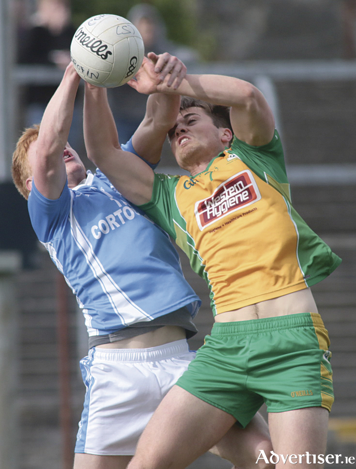 Adrian Varley of Cortoon Shamrocks and Liam Silke Corofin tussle for possession in the Galway County Senior Club Football Championship at Tuam stadium on Sunday. Photo:-Mike Shaughnessy