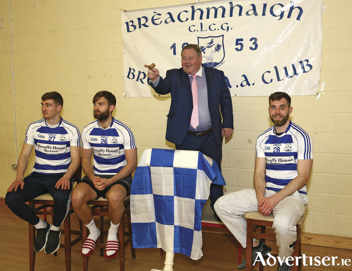 Auctioneer Tommy Collins prepares to take bids for the coaching services of the O'Shea brothers, Conor, Aidan and Seamie, ahead of Breaffy GAA's Monster Auction later this month. Photo: Michael Donnelly