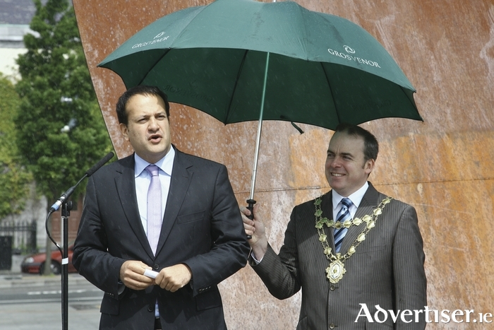 Leo Varadkar speaking in Galway in 2011, and protected from any inclement weather by Fianna Fáil's Michael Crowe. Photo:- Mike Shaughnessy
