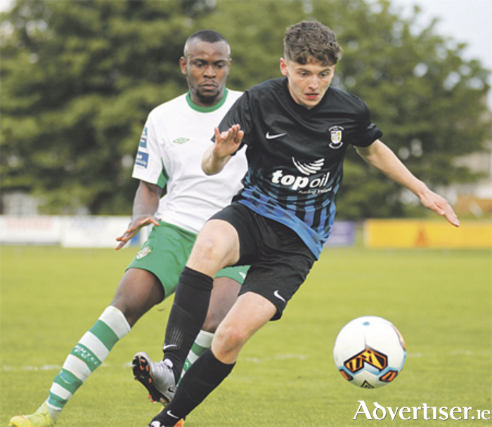 Joe Carmody gets away from Christian Lotefa during his senior debut for Athlone Town