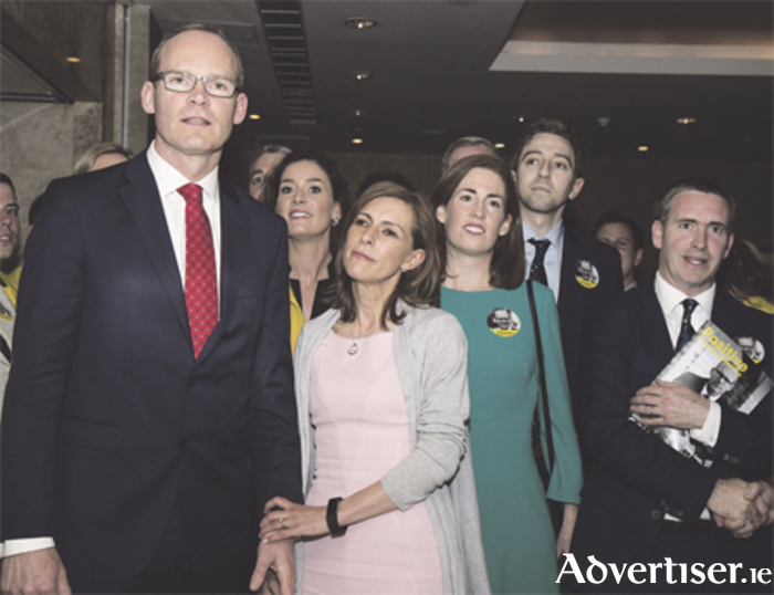 Minister Simon Coveney and supporters. Photo: Mags Cunney