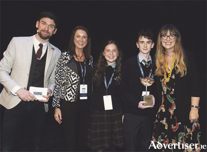 Athlone Community College won the top prize in the Best Costumes category for their production of 'We Will Rock You' at the Bord Gáis Energy Student Theatre Awards in Dublin. Pictured are: presenter, Eoghan McDermott; teacher, Niamh Donohoe; students, Clodagh Moxham and Cian Mulhall; and Tanya Townsend, sponsorship programme manager with Bord Gáis Energy.