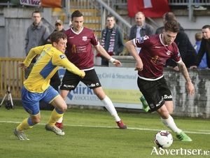 On the ball:  Galway United's Stephen Folan  in control, chased by Caolan McAleer of Finn Harps  in the SSE Airtricity League game at Eamonn Deacy Park. 			     	                     Photograph: Mike Shaughnessy