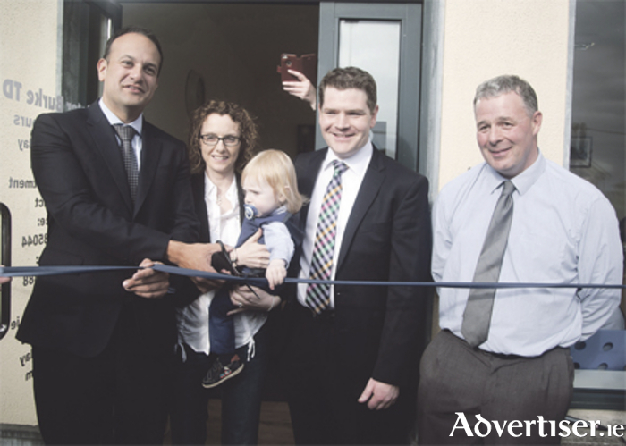 Minister for Social Protection Leo Varadkar took time out from his leadership campaign on Monday this week to officially open Deputy Peter Burke's constituency office in Mullingar. Also pictured is Deputy Burke with Olivia his wife, and their son Leo; and Cllr Andrew Duncan.  Photo: Thomas Gibbons