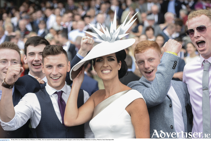 Lisa McGowan, from Tullamore, Co Offaly, who was named best dressed lady, pictured with racegoers at the Galway Races in Ballybrit last year.Photo by Cody Glenn/Sportsfile