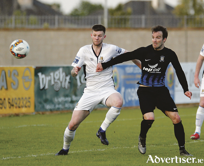 Athlone Town goal scorer Walter Invernizzi gets to grips with Waterford defender Gary Comerford