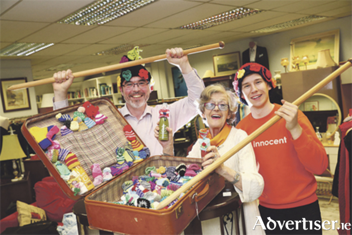 Delo McArdle, joined by Age Action's Justin Moran and innocent drinks' Matthew Gavin, urging Ireland's knitters to get involved in the innocent Big Knit