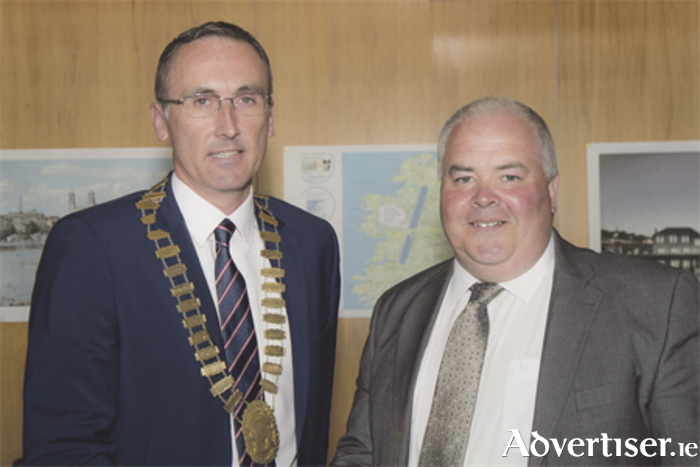 Outgoing Mayor John Dolan hands the chain of office over to the new Mayor of Athlone, Aengus O'Rourke. Photo: Mags Cunney