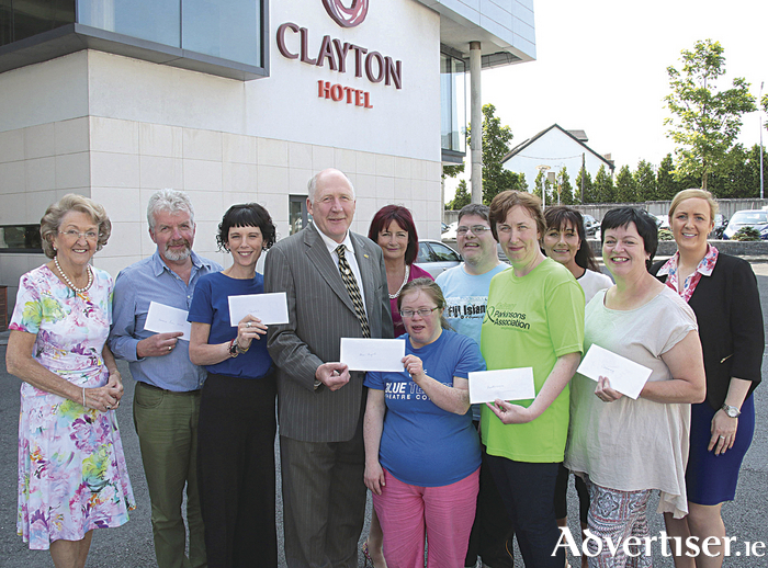 Mayor of Galway City Noel Larkin presents the proceeds of The Mayoral Ball to Galway charities at the Clayton Hotel which hosted the event. Pictured with Mayor Larkin are (l-r) Mary Bennett (event organiser) Derek Kerrigan (Corrib Lions Club) Ann Kenny (Sonnas), Carmen Taheny (ISPCC)  Jennifer Cox and Kieran Coppinger (Blue Teapot Theatre Company) Marie Cahill ( Parkinson Association) Deirdre Hurney (Mayor's PA) Mary Bracken (Crannóg) and Karina Duffy, The Clayton Hotel. Photo:-Mike Shaughnessy